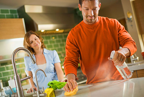 getty_rm_photo_of_man_disinfecting_kitchen_counter
